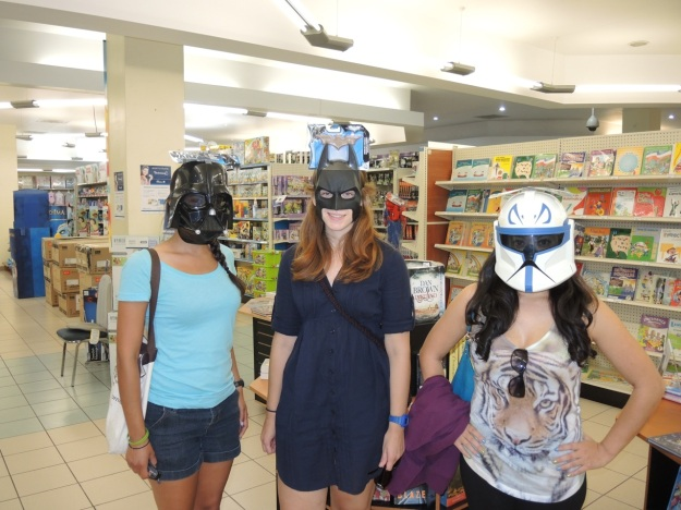 Three of the ladies don masks they found in one of the stores.